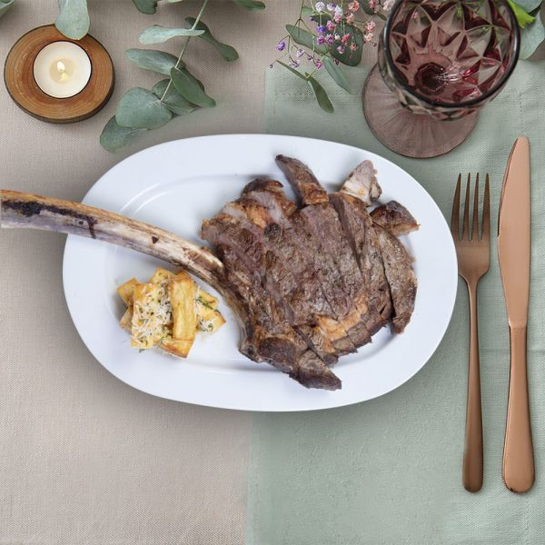aged_tomahawk_steak_with_hand_cut_chips_the_artisan_food_company